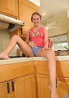 Anilos mom Sara James takes off her panties and plays her black vibrator in the kitchen