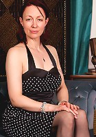 Sweet sexy mom in polka dot dress reveals her sexy lingerie