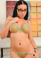 Cougar secretary removes her dress revealing her sheer bra and thong