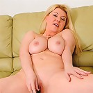 Busty blonde cougar Venice Knight stuffs her cock craving pussy with a glass dildo
