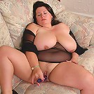 Plumper Angel plays with her massive juggs and dildo fucking