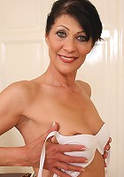Popular office MILF Kitty S shows off her 52 year old beaver at work