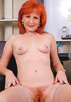 Sasha B shows off her naturally hairy and very red bush here