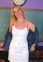 Horny blonde Katrina plays teacher and spreads her older legs