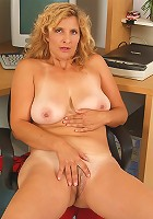Busty MILF Tara from AllOver30.com shows off her shaven pussy