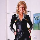 Leggy MILF Liz from AllOver30 strips and spreads her ass here