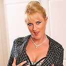 Tall blonde MILF unwinds after a day in the office