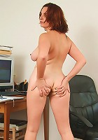 Bored at the office she decides to strip and play with her box
