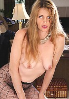 Elegant blonde Jose from AllOver30 strips and spreads in fishnets