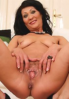 Elegant and exotic Princess D reveals her hot mature pussy in here
