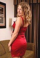 30 year old Sara C from AllOver30 slides out of her elegant red dress