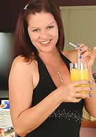 39 year old Xena from AllOver30 strips after enjoying a bit of OJ