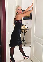 Elegant 34 year old blonde Beth strips and shows off her athletic body