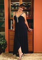 35 year old redheaded Julie slips out of her elegant dress and spreads