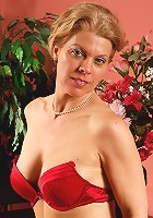 Elegant 48 year old Lauren E showing off her red bra and panties