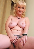 Busty blonde MILF with big tits and a shaven mature pussy