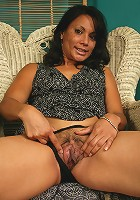 Spicy brunette Dez spreads her furry but neat pussy on the couch