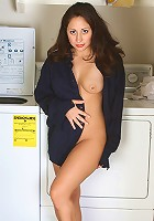 Cute brunette housewife takes a break from the laundry to strip