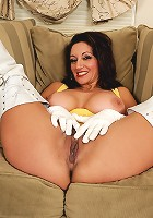 Busty 51 year old Persia from AllOver30 in white knee-high boots