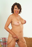 This Cuban MILF strips to show us her spice hot beaver