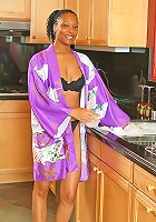 37 year old ebony chick gets naughty in the kitchen