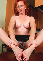 All natural red headed MILF shows off her sexy feet and hairy pussy