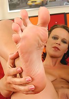 Cadence shows off her big titties then creams her lovely toes here