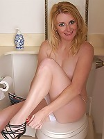 Hot and mature blonde poses and pees in this gallery