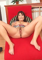 Sophia M spreads her furry pussy and squeezes her juicy melons