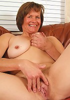 Horny older Carmen spreads wide to reveal a mature and hairy pussy
