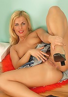 Blonde MILF with a very hairy pussy shows us what shes got