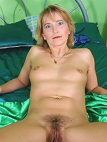 Kates fingers her mature and hairy pussy in this one