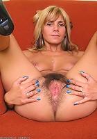 Monica pulls her white panties aside revelaing thick bush