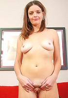 Mature housewife Marie from AllOver30 gets naked on the red couch