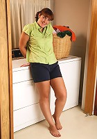 35 year old housewife Julie decides to strip and spread in during laundry