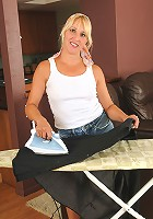 Blonde housewife Andi stops ironing and strips off her denim shorts