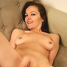 MILF with a fantastic puffy pussy after removing her denim jeans