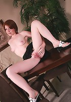 Sexy short haired redhead from AllOver30 spreads her legs for you