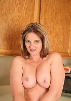 Busty MILF Stacellia displays her hot older body on the cupboards