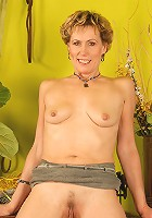 Georgina C spreads her meaty pussy wide open for the camera