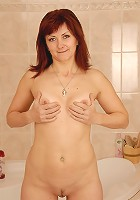 41 year old redhead strips and washers her pussy in the shower
