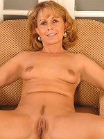 A hot 44 year old Chezh bombshell shows her wet pussy here