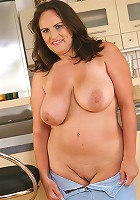 Busty MILF Olarita has fun with her boobs after her housework