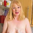52 year old Amanda having fun with bubbles and boobs in here