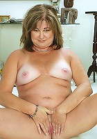 Fun loving Ruby gets naked and plays with her mature pussy