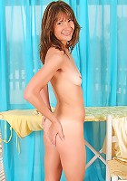 Kari looks great posing naked after doing the housework