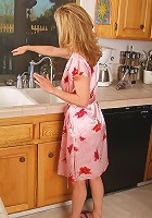 Gorgeous 54 year old getting naked in the kitchen here