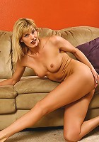 Tight assed Tabitha in purple lingerie spreads her legs
