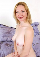 Damn hot MILF posing for the camera in this one