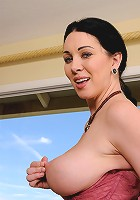Gorgeous brunetter RayVeness pulls at her full mature boobs in here